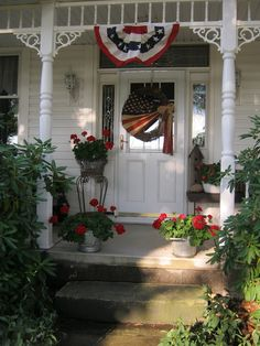 """Americana porch"" ""Fourth of July decorations"" ""flowers and flags"" ""red, white and blue decorations"" ""decorations for the porch"" White And Blue Flowers, Red And White, Fresco, Red Geraniums, Potted Geraniums, Decks And Porches, Front Porches, Primitive Homes, Patriotic Decorations"