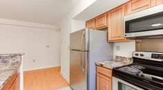 The Oaks Apartments | Southeast Washington, DC | Affordable Apartments in DC | Anacostia Neighborhood | Granite Covered Counters | Laminate Wood Flooring | Renovated Community | Kitchen With Stainless Steel Appliances |