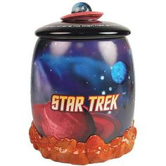 """38.99 Boldly go... after your cookies! Enterprise Cookie Jar features alien planets and the Star Trek logo. Cover says """"To boldly go where no man has gone before."""""""