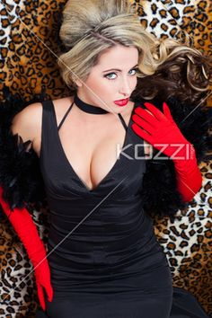 attractive female in black dress posing for the camera. - Portrait of a attractive young female fashion model posing for the camera while lying on the floor, Nadine Yelovich