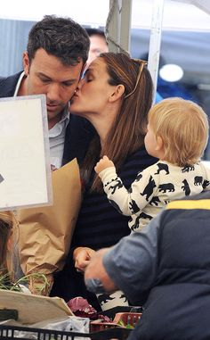Awwwww! Jennifer Garner steals a kiss from hubby Ben Affleck while the family does their Sunday farmers market shopping.
