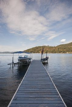 Welcome to Bottle Bay, a cabin on the Lake! Here's your Summer get-a-way at Lake Pend Oreille! All set up for maximum enjoyment including a covered boat lift at the end of your private dock. Huge deck and gently sloping grass to the water's edge. 2 bed and 2.5 bath, a third large room being used as bedroom, tile in the kitchen, and gorgeous views across the lake! This is the retreat you've been waiting for, the place your children & grandchildrenwill remember! Call today.