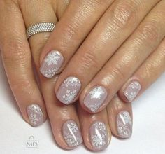 It's simple, but very soft in the same time manicure, which will look great on nails in winter. The main colour – is soft milky-beige shade, coated by intr