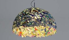 The Frankfurt-based design studio Yeayea, created this lamp out of recycled CD's. There is no glue attaching them, rather the CD fragments are melted together in a mold.