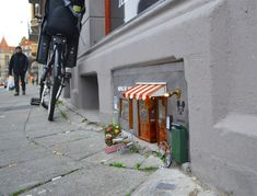 AnonyMouse Wedges Miniature Shops and Restaurants Built For Mice into Busy City Streets | Colossal