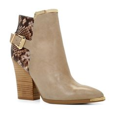 Yolandah boots by ALDO. The gold metal accents add the finishing touch to these structured ankle boots. - Zip boot. - Sin...