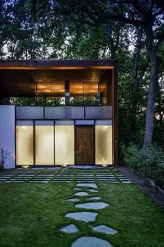 Minimalist exterior, wood, steel and glass, large pavers and irregular flagstone