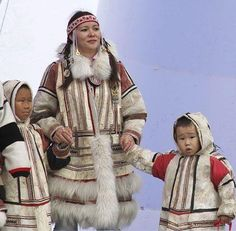 Nganasans famuly in traditional dress. The Nganasans are an indigenous Samoyedic people inhabiting the Taymyr Peninsula in north Siberia, Russia