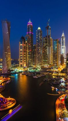 This is a photograph of the city of Dubai. The thing I like about this image is that it shows you the skyline of modern cities as the buildings are more 'weird and wonderful' due to the contemporary themes of modern construction Amazing Buildings, City Buildings, Amazing Architecture, Dubai City, Dubai Uae, Wallpaper Ciudades, Places Around The World, Around The Worlds, Wonderful Places