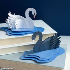 Download our templates and follow our easy photo tutorial to make your very own paper swans! Simple elegance that will take you no time at all to create!