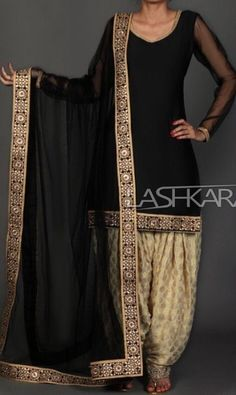 Black and Golden Brocade Punjabi Suit features a taffeta silk kameez with santoon inner, brocade salwar and net dupatta. Embroidery work is completed with lace and sequins embellishments. Designer Salwar Kameez, Indian Salwar Kameez, Salwar Kameez Simple, Patiala Salwar Suits, Churidar, Punjabi Fashion, Bollywood Fashion, Indian Fashion, Emo Fashion