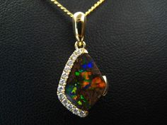 Diamond rock'n roll! A sparkly boulder opal that looks like the rainbow dropped on the ironstone! #Melbourne #lightningridgeopalmines