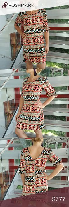 "Playful print dress NWT Brand new with tags  *Made in the U.S.A*   Fabulous multi color and print dress. Flattering and comfortable fit. Pair with blue statement earrings and black heels for a chic look  Length approx 32"" Bust approx 16.5"" Zips up in back 100% polyester  Size small Dresses"