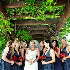 charcoal gray bridesmaid dresses with red bouquets
