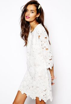 Brides.com: 37 Little White Dresses You Can Buy Right Now. Shift dress in lace cutwork, $110.51, Native Rose available at ASOS See more lace wedding dresses.