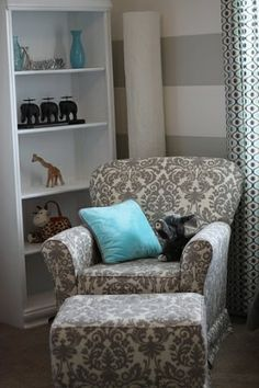 chair & pillow, white and grey stripe walls with blue accent