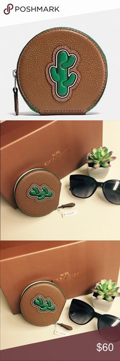 """Coach Round Cactus Coin Case Pebbled Leather NWTs Coach-Green cactus brown pebbled leather round zip coin case. New with tags- Super cute and trendy! 4""""Lx 3 3/4""""H--( free mystery gift with this purchase!)--this cactus line is being discontinued ( so I was told at the Coach store, and will be hard to find) (does not come with box pictured). Would make a perfect gift or addition to any Coach lovers collection. Coach Accessories"""
