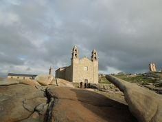 Santuario da Virxe da Barca e pedra dos cadrís á dereita #Costadamorte Muxía