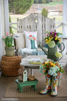 Spring on the porch with watering can, wellies, flowers, birdhouse | ©homeiswheretheboatis.net #spring #garden #flowers #FloralFriday