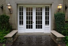 The elegant white double french door entranceway above is very simplistic. A statement in itself, the stone walkway leading up to the doors, the twin bordering concrete seats and the two coach lights give you a feeling of abundance inside Front Door Entrance, Entrance Ways, Front Entrances, Entry Doors, Garage Doors, Front Doors, Double Doors Entryway, Porch Doors, Front Entry