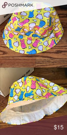 Peeps Bucket Hat Perfection !! good for Easter or just whenever.  Brand is peeps but I think it looks a lot like the lazy oaf designs.  it is plastic coated cotton i believe. Lazy Oaf Accessories Hats