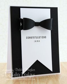 Jazz up some black and white cardstock with a bow tie and you have an elegant handmade congratulations card. This tie was made using a small die, and you can add some shiny rhinestones for some bling.