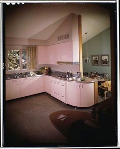 Pink kitchen with the steel cabinets! --  Pace Setter House, Maynard Parker, 1949