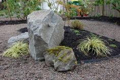 Selectively adding boulders can instantly make your landscape appear timeless, Bowen says. (Photo courtesy of Ross NW Watergardens)