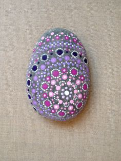 If you find a rock this smooth and round, then paint it creatively like this. It would make a nice paperweight.