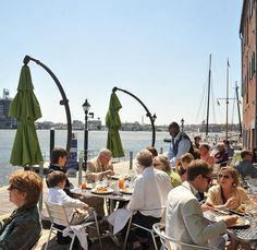 Top 10 Baltimore-area outdoor dining spaces! The views from the patio at Waterfront Kitchen sweep around the harbor, taking in sailboats and mammoth tankers docked at Domino Sugar.