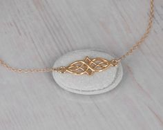 https://www.etsy.com/listing/231526820/gold-celtic-necklace-dainty-gold-fill