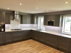 This Fairford Kitchen in Slate Grey with Quartz Worktops was designed by our Burton on Trent depot. For more inspiration, visit Howdens.