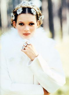 Kate Moss with flowers in her hair photographed by Arthur Elgort for Vogue Italia, October 1992