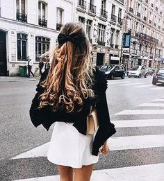 Cute black top with white mini skirt.