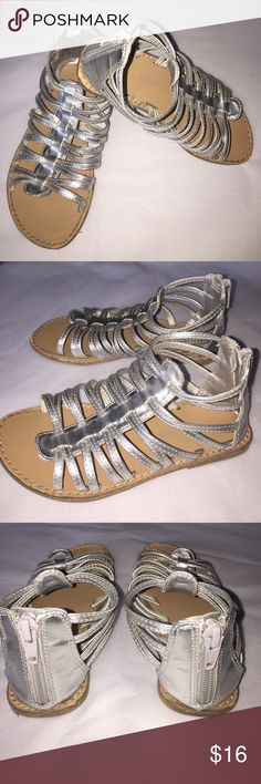 Cute Girls Sandals Silver Back zipper matches all Cute Girls Sandals Silver Back zipper matches all size 10 Good Condition! Plenty of life left. Pre- loved but still in good condition. See photos. Old Navy Shoes Sandals & Flip Flops