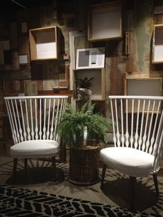 Waiting area at Iscd reception featuring custom recycled timber wall and the stunning Patricia Urquiola Nub chair