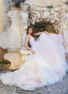 Just look at this deliciously frothy wedding dress below with its simple bustier top and mega-princess skirt. | See more Spring 2015 wedding dress trends here: http://www.mywedding.com/articles/spring-2015-wedding-dresses-favorite-trends/?utm_source=pinterest&utm_medium=social&utm_campaign=fashion_style