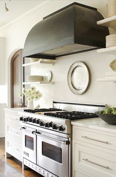contemporary classic kitchen.  open shelving and oiled bronze hood.