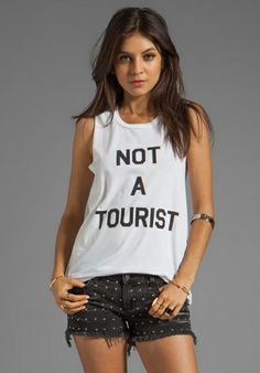 LOCAL CELEBRITY Not A Tourist Muscle Tee in White at Revolve Clothing - Free Shipping!