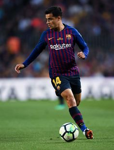 Philippe Coutinho of FC Barcelona runs with the ball during the La Liga match between Barcelona and Real Sociedad at Camp Nou on May 20, 2018 in Barcelona, Spain.