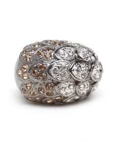 How stunning is this cocktail ring? It features a glittering array of mermaid-like scales-covered in white ice and amber crystals-that evokes an Old Hollywood glamour, Busby Berkeley aquacade-style.