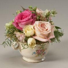 Cute little tea cup flower arrangement. by jacqueline