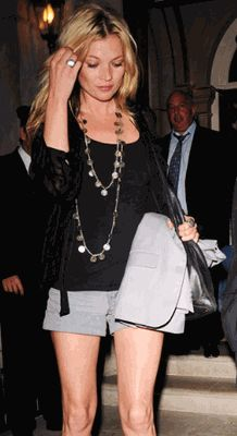 Kate Moss wearing a Ben Amun gold plated brass French coin necklace.