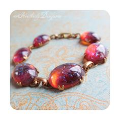 Lava Lush: mexican opal dragon's breath glass stone and brass tennis... ($68) ❤ liked on Polyvore featuring jewelry, bracelets, opal tennis bracelet, brass jewelry, imitation jewellery, opal jewelry and tennis bracelet