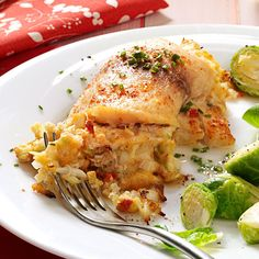 Crab-Stuffed Tilapia Recipe -Make a reservation for four at your dining room table. With this elegant, restaurant-quality dish, you can turn an ordinary Tuesday night into a supper celebration. —Linda Stemen, Monroeville, Indiana
