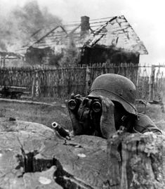 """panzerbekampfer: """"An officer of the German infantry searches the area for enemy troops during a skirmish at a Russian village.. """""""
