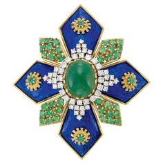 Gold, Cabochon Emerald, Diamond, Emerald and Blue Enamel Clip-Brooch  The stylized Maltese cross centering one oval cabochon emerald, surrounded by 48 round diamonds approximately 1.70 cts., quartered by rays applied with blue enamel, centering textured gold starbursts further centering 4 round emeralds, spaced by diamond-shaped panels set with 36 round emeralds,