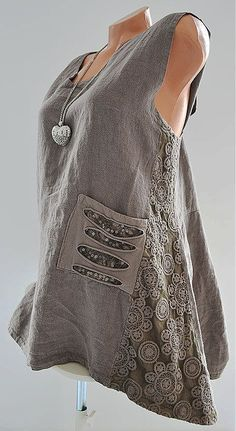 Simple shell tanks like this, with a higher than normal neck, are great for showing off statement jewelry, and layer easily under a lightweight cardigan- style sweater, or other open front shirt.
