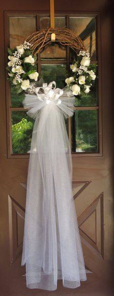 Brides Wanted! Our White Rose Wedding Wreath is sophisticated and elegant! Its made with artificial white roses and babies breath as well as