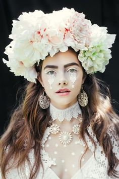 From the bright beads to the bold makeup to the bouquets balanced as exuberant crowns, these photographs by Ula Kóska are rich with color, pattern, and texture.